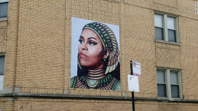 The mural is on a building a few blocks from where Michelle Obama grew up.