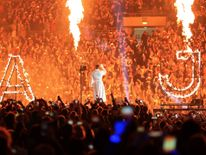 Anthony Joshua makes his entrance prior to his fight against Wladimir Klitschko for the IBF, WBA and IBO Heavyweight World Title bout at Wembley Stadium