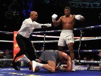 Wladamir Klitschko goes down against Anthony Joshua during the IBF, WBA and IBO Heavyweight World Title bout at Wembley Stadium