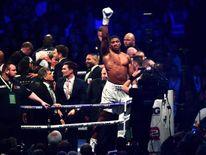 Anthony Joshua celebrates victory